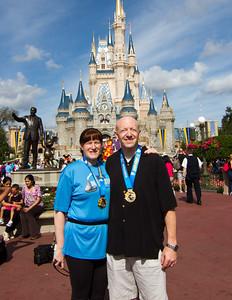 Magic Kingdom Visit - Susan & Scott with Medals