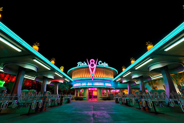 """Flo's V8 Cafe in Cars Land at Disney California Adventure looks awesome at night, with all of its neon goodness! <br /> <br /> See more Cars Land photos by Tom Bricker: <a href=""""http://www.disneytouristblog.com/cars-land-photos/"""">http://www.disneytouristblog.com/cars-land-photos/</a>"""