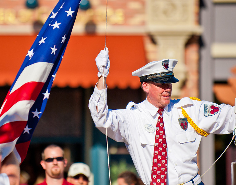 "The flag retreat is an important part of the day at Disney. <br /> <br /> See more patriotic Disney photos: <a href=""http://www.disneytouristblog.com/patriotic-disney-photos/"">http://www.disneytouristblog.com/patriotic-disney-photos/</a>"