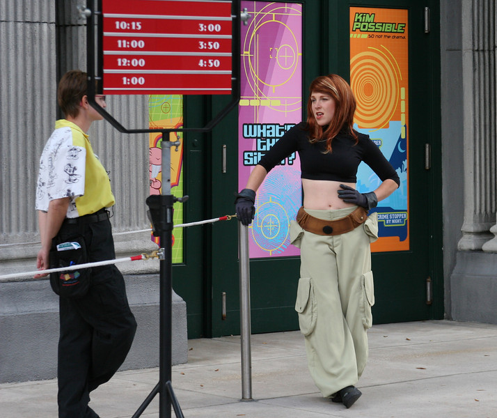 Kim Possible hanging out on the streets of Walt DisneyWorld, keeping everyone safe.