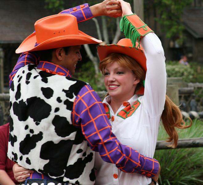A pair of dancers at the Magic Kingdom park.