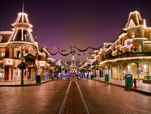 """An empty Main Street, USA in Disneyland Paris, with the Christmas tree at the end of the street near the EuroDisney Railroad Station. <br /> <br /> Read more about Disneyland Paris Christmas:  <a href=""""http://www.disneytouristblog.com/disneyland-paris-christmas/"""">http://www.disneytouristblog.com/disneyland-paris-christmas/</a>"""
