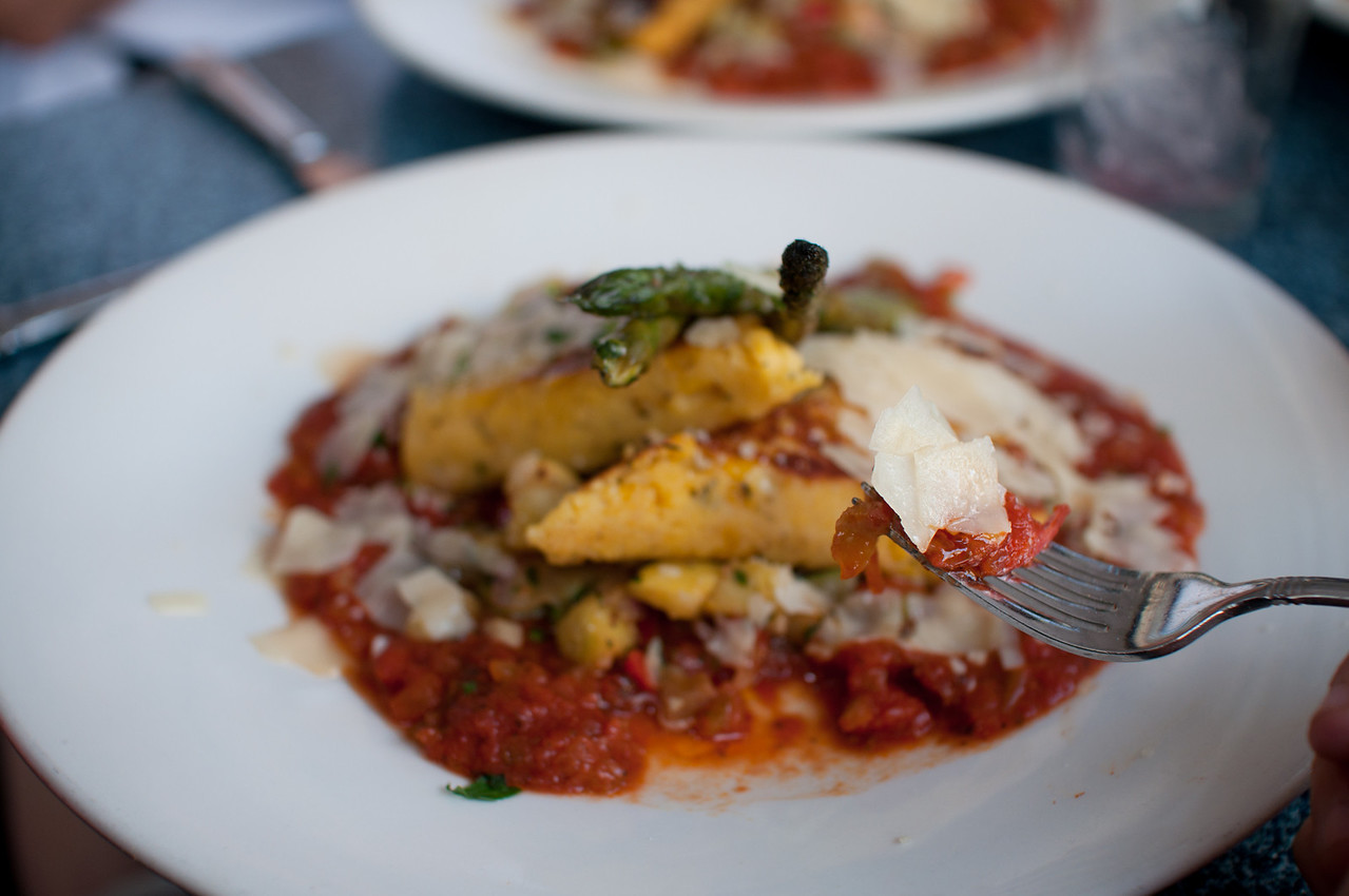 Cafe Orleans N'awlins Vegetable Ragout - Vegetable Ragout with Eggplant, Red Onions, Bell Peppers, Squash, Zucchini, and fresh Garlic served with Corn Cakes topped with Grana Padano Cheese.