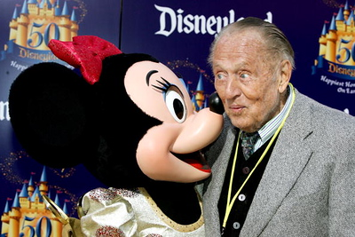 "ANAHEIM, CA - MAY 04:  Actor Art Linkletter is seen with Minnie Mouse attending the ""Gold Carpet"" arrivals on Main Street U.S.A. during the Disneyland 50th Anniversary Celebration at Disneyland Park on May 4, 2005 in Anaheim, California.  (Photo by Frazer Harrison/Getty Images)"