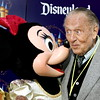 """ANAHEIM, CA - MAY 04:  Actor Art Linkletter is seen with Minnie Mouse attending the """"Gold Carpet"""" arrivals on Main Street U.S.A. during the Disneyland 50th Anniversary Celebration at Disneyland Park on May 4, 2005 in Anaheim, California.  (Photo by Frazer Harrison/Getty Images)"""
