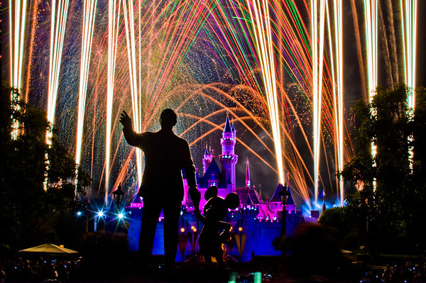 """""""Magical"""" fireworks explode behind Walt Disney and Mickey Mouse at Disneyland. <br /> <br /> Need assistance planning a trip to Disneyland? Read our comprehensive tips:  <a href=""""http://www.disneytouristblog.com/disneyland-first-time-visit-2012/"""">http://www.disneytouristblog.com/disneyland-first-time-visit-2012/</a>"""