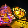 "Astro Orbiter spins at night in the entranceway to Tomorrowland. <br /> <br /> See tons more photos from this, our first Disneyland trip here: <a href=""http://www.disneytouristblog.com/disneyland-disney-california-adventure-august-2010-trip-report/"">http://www.disneytouristblog.com/disneyland-disney-california-adventure-august-2010-trip-report/</a>"