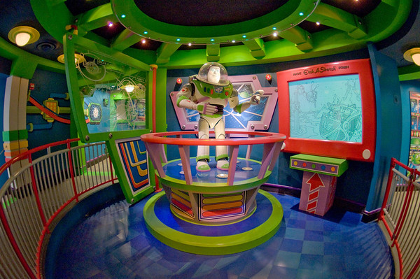 """Buzz Lightyear Audio-Animatronics figure in the queue for Astro Blasters at Disneyland. Photo taken with a Rokinon 8mm fisheye lens.<br /> <br /> Lens review: <a href=""""http://www.disneytouristblog.com/8mm-fisheye-samyang-rokinon-lens-review/"""">http://www.disneytouristblog.com/8mm-fisheye-samyang-rokinon-lens-review/</a>"""