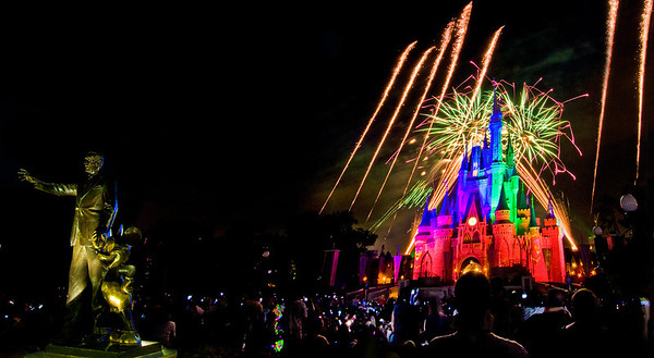 Fireworks over Cinderella Castle in the Magic Kingdom with Partners in the foreground.