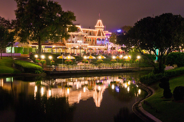 """The Plaza Restaurant as seen from the Tomorrowland bridge. <br /> <br /> It may come as a surprise, but we aren't fans of the Plaza. Here's our review: <a href=""""http://www.disneytouristblog.com/plaza-restaurant-review/"""">http://www.disneytouristblog.com/plaza-restaurant-review/</a>"""