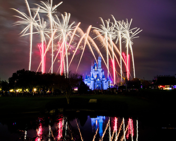 Holiday Wishes fireworks over the Magic Kingdom at Walt Disney World.