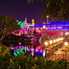 "Tomorrowland at night, as viewed from Main Street. Photo taken with the Sigma 30mm f/1.4 lens. <br /> <br /> Lens review: <a href=""http://www.disneytouristblog.com/sigma-30mm-f1-4-lens-review/"">http://www.disneytouristblog.com/sigma-30mm-f1-4-lens-review/</a>"