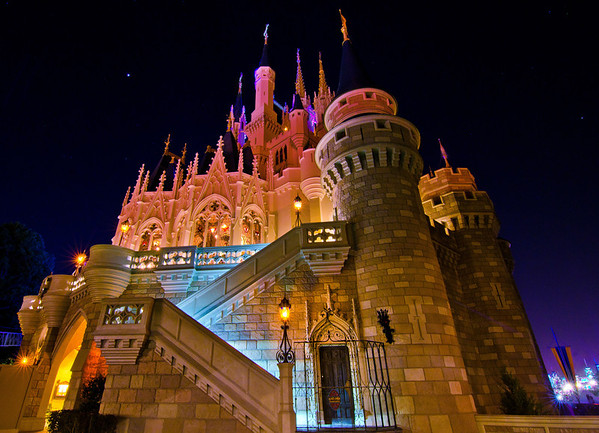 """Ultra wide angle side view of Cinderella Castle with special lighting during Mickey's Not So Scary Halloween Party.<br /> <br /> <a href=""""http://www.disneytouristblog.com/mickeys-not-so-scary-halloween-party-review-tips/"""">http://www.disneytouristblog.com/mickeys-not-so-scary-halloween-party-review-tips/</a>"""