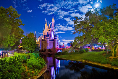 On this particular night at Walt Disney World, Cinderella Castle in the Magic Kingdom was lit up by a brilliant full moon, rather than the artificial light normally on the Castle.   Read more: http://www.disneytouristblog.com/cinderella-castle-by-the-light-of-the-moon/