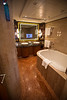 The bathroom, with TV embedded in the mirror. The Whirlpool (TM) tub was huge!
