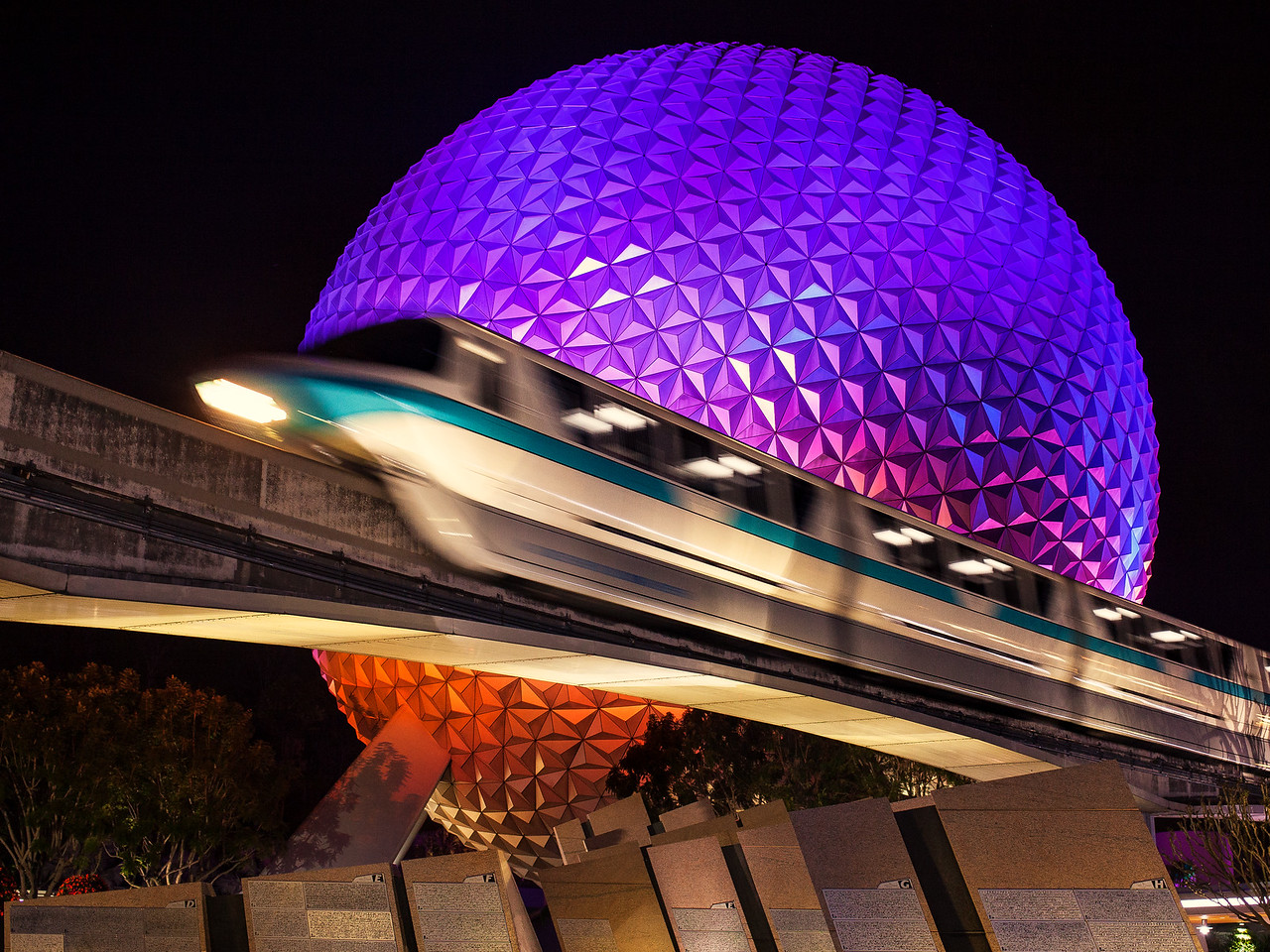 Monorail Passing In Front Of Spaceship Earth