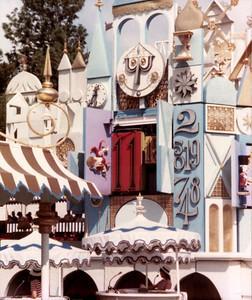 Small World detail: clock chiming 11:00.