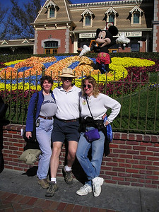 Linda, Paul, Ellen at train station and 50th anniversary flowers front entrance