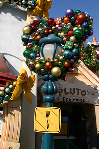 """Toon Town xmas decor on \""""fork in road\"""" sign."""