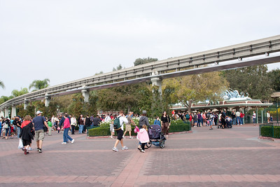 The lines are forming as people approach the Disneyland entry gates below the monorail track.