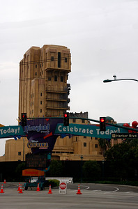 Disneyland entrance sign with the Tower of Terror behind.