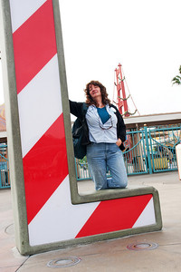 Linda and the L in CALIFORNIA with California Adventure entry gates behind.