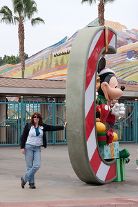 """Linda and the """"C"""" in CALIFORNIA, decorated for the holidays."""