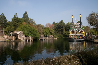 ... 2009, on the opposite side of Tom Sawyer's Island from the raft ride, there is a mill on the left and a little structure to its right.