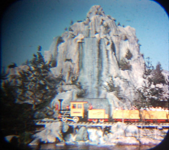 1959 Viewmaster of the big waterfall at the northeast end of  Rivers of America and the Mine Train going past it.  Several years ago, we realized that the water was no longer falling, but the huge artificial rock structure remained (very covered with trees).
