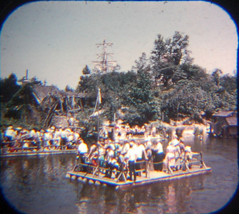 1959 Viewmaster of the rafts to Tom Sawyer Island. Note the position of the mill on the left and the little structure on the right.