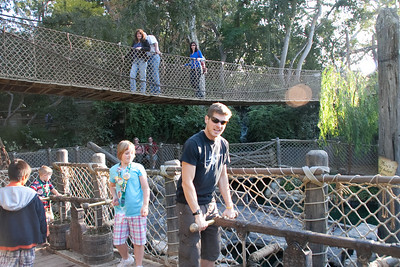 2009 suspension bridge on Tom Sawyer's Island. Notice how people are dressed. I couldn't get the exact angle as in the 1959 view because of huge trees and shrubs in my way. But you can see that, instead of there just being an empty pond, now there's a bunch of interactive pirate-related stuff going on in the lagoon below the bridge.