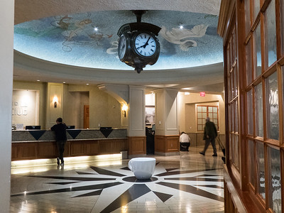 United Premier Club atrium, fancy ceiling and clock