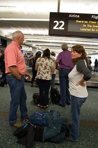 Paul and Linda waiting at baggage claim in Orlando