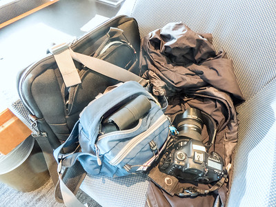 Ellen's carry-ons: computer, camera, coat, etc.
