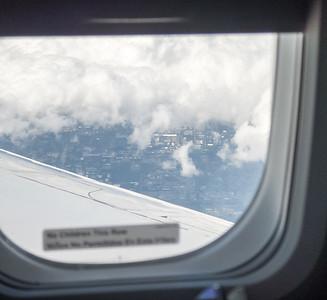 P1020938AirplaneWindowCloudsGround_twkscr_sm