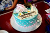 Custom cake from the Contemporary bakery.  Three layer, white cake with white chocolate mousse filling, white chocolate buttercream and teal fondant.  I had been working with the pasty chefs assistant for a few months to design the perfect graduation/dance cake for her.