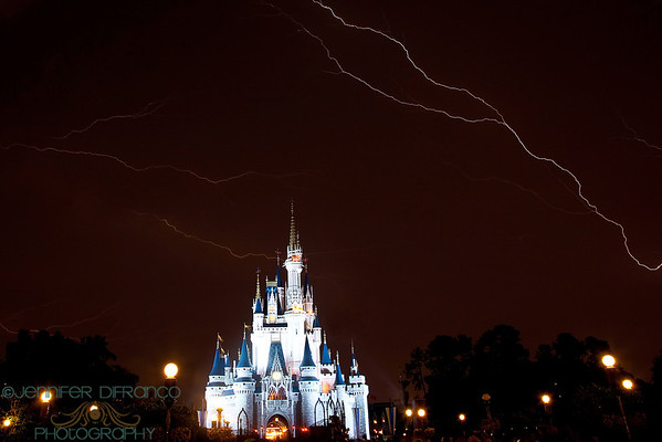We had lugged the tripod over to the Magic Kingdom to get photos of the Castle show (Magic Memories and You) as well as Main Street Electrical Parade and Wishes (fireworks).  Well  the parade was canceled due to lightening. The firework were delayed.... and delayed.....  and delayed...  and delayed. The park was due to close at midnight.  We packed up and left around 11:20.  We rode the monorail back to our resort, climbed into bed and - yup - the fireworks started at 11:50 pm!