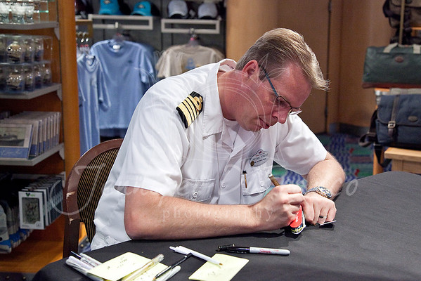 The ships captain signing our Christmas ornament.