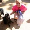 "In between all the rides Nancy took a little time to say hi to some of the little guys at the petting zoo at ""Big Thunder Ranch"". :-)"