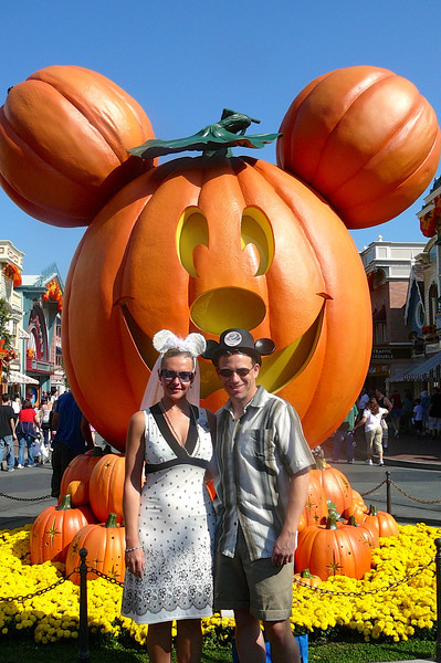 Here we are on Day # 2 of our Honeymoon visit to Disneyland... what a great way to start the day, getting our picture taken in front of a pumpkin!! :-)