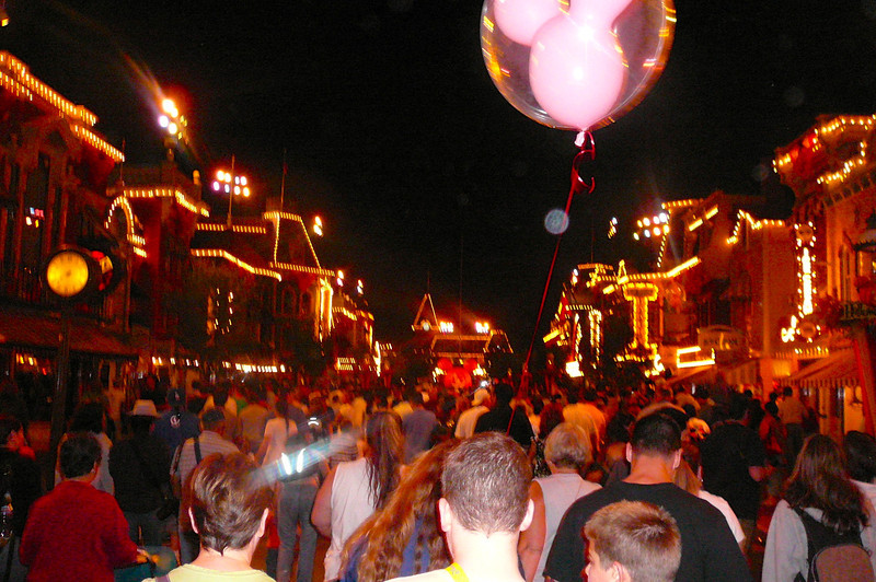 """""""Main Street"""" Disneyland gets to be a very busy place at closing time every night... we Love the slow walking place though as it gives us lots of time to admire the Beautiful place (check out all those lights) that Walt built!!"""
