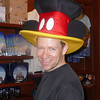 There's Shawn having a little fun trying on some hats in the shops in Disney World. :-)