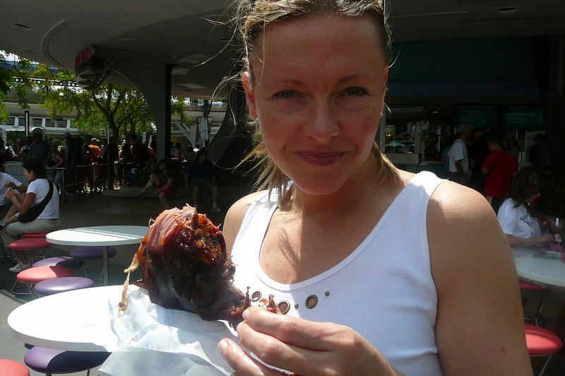 Nancy couldn't resist the popular Turkey Legs at the Park. :-)