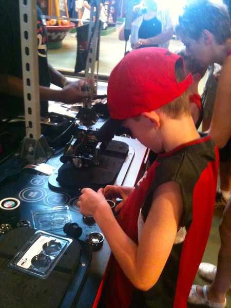 """And there's Richard building his own Custom remote control car at """"Ridemakerz"""" in Downtown Disney... cool... Shawn wishes they had this when he was growing up! :-)"""
