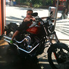 "There's Johnnie checking out a ""Harley"" in Downtown Disney... he looks like a natural! :-)"