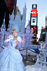 "(OCT. 17, 2012):  Disney Princess Cinderella poses Oct. 17, 2012 in front of a 25-foot-tall ice castle sculpture in Times Square in New York City.  Disney Parks unveiled a 25-foot-tall, 45,000-pound castle made of ice as the sun rose Oct, 17, 2012 over Times Square in New York City.  The icy structure was unveiled during the Disney Parks announcement of ""Limited Time Magic"" that will take place throughout 2013 at Disneyland Resort in California and Walt Disney World Resort in Florida.  Next year, each week at the Disney theme parks will be highlighted by a different surprise or guest enhancement for a one-week-only engagement.  Each weekly surprise, many never-before-seen in the Disney Parks, will include entertainment, dining, character experiences and more.  Each one will disappear after seven days and make way for the next week's Limited Time Magic experience.  Combined with the heat of the morning and early-afternoon sun, the ice castle in Times Square -- which took more than 12 hours to construct and craft -- demonstrates the short-lived nature of Disney's Limited Time Magic.  (David Roark, photographer)"
