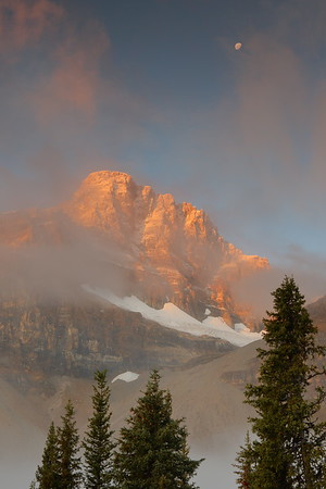 Misty sunrise and moon in Jasper National Park, Alberta, Canada. © 2019 Kenneth R. Sheide