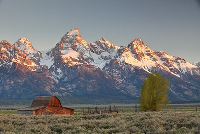 Sunrise on the grand tetons with Mormon barn in foreground, WY. © 2013 Kenneth R. Sheide
