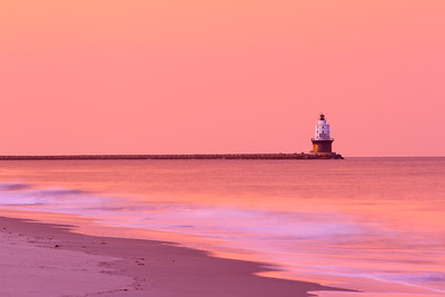 The Harbor of Refuge Light on its breakwater which protects the entrance to the Delaware Bay.  Cape Henlopen, DE. © 2011 Kenneth R. Sheide