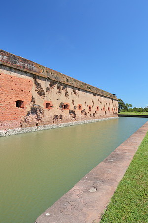 Cannon damage to exterior wall caused during Union attack during Civil War. Fort Pulaski, GA. © 2021 Kenneth R. Sheide